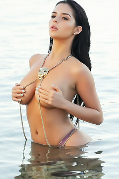 Demi Rose Hiding Boobs At The Beach